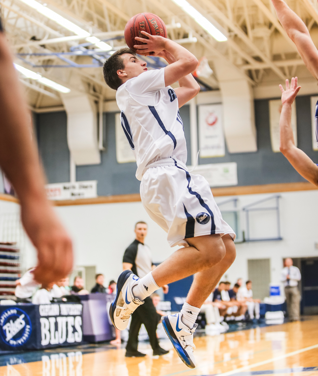 Blues basketball dominate Bearcats and Eagles