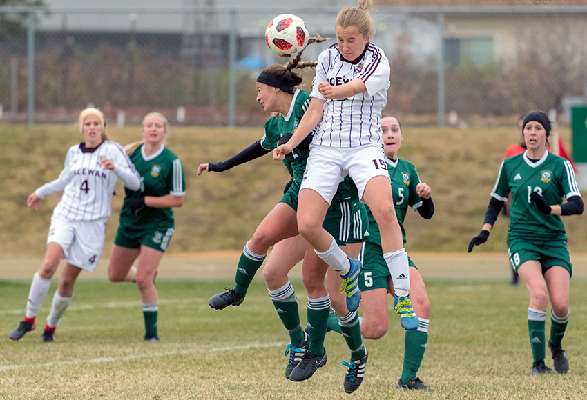 MacEwan's Maya Morrell takes to the air to battle for a ball against Alberta during their playoff match at Foote Field last fall. The Edmonton rivals will meet twice during the 2019 regular season (Chris Piggott photo).