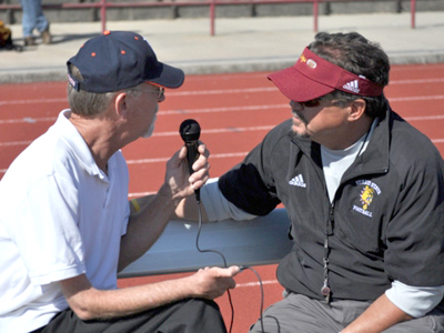 Ferris State head coach Jeff Pierce (right) is interviewed at last year's media day event