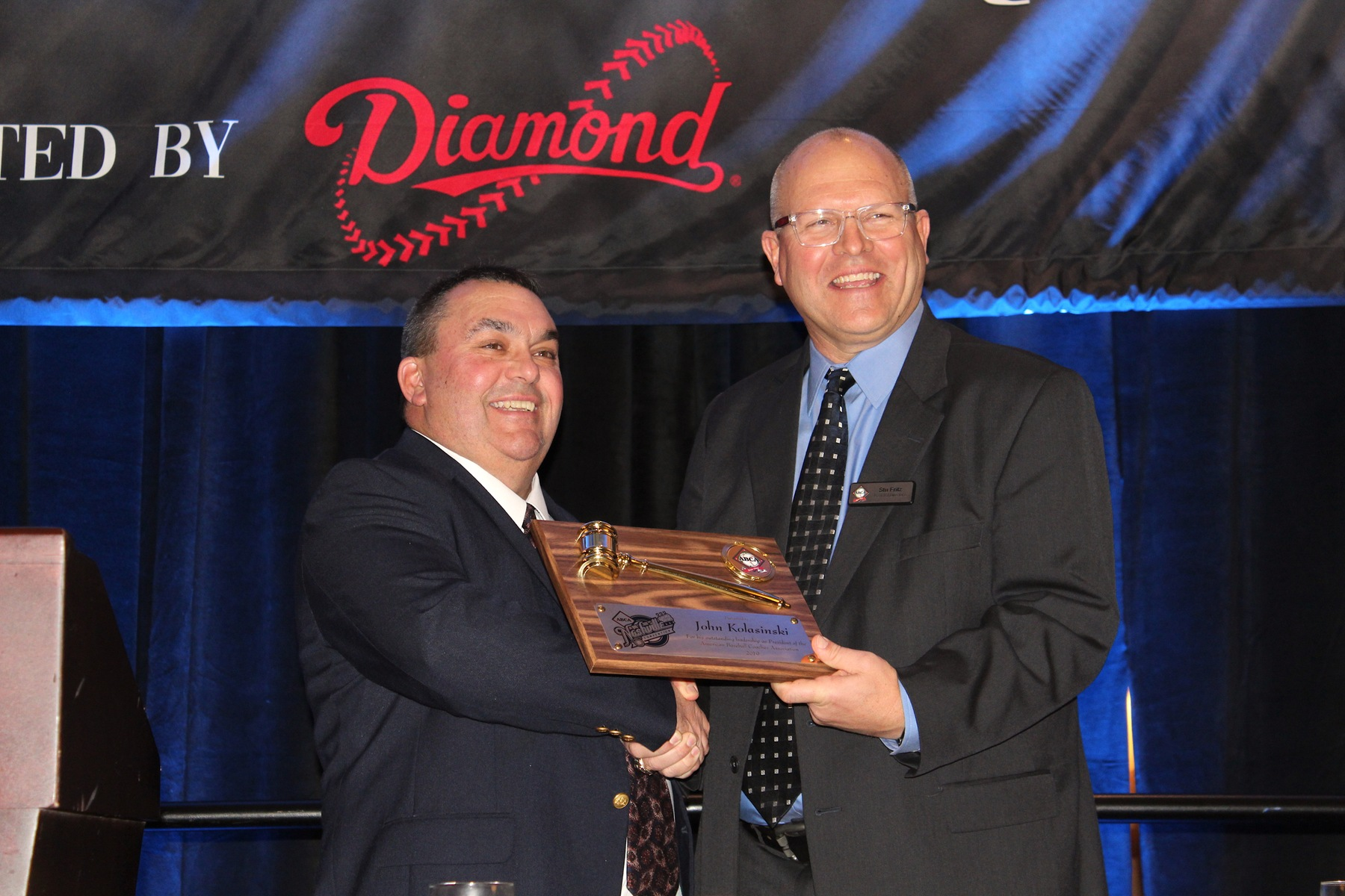 Stu Fritz, left, accepts the ceremonial ABCA presidential gavel during the national convention in Nashville, Tennessee.