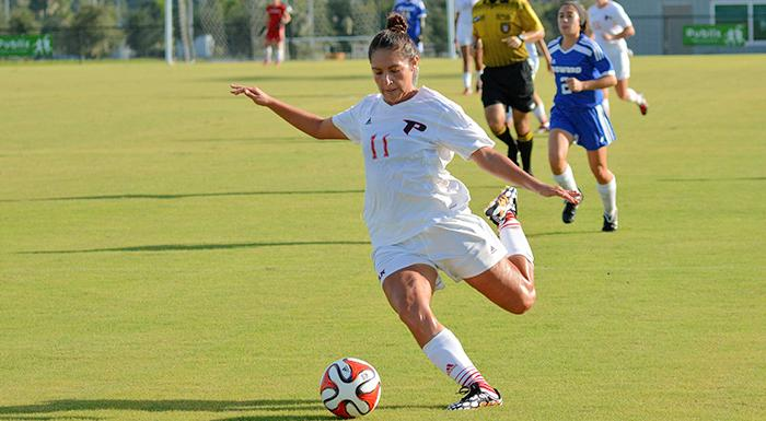 Cristina Gutierrez scores one of Polk State's four goals in today's 4-0 victory over Broward College. (Photo by Tom Hagerty, Polk State.)