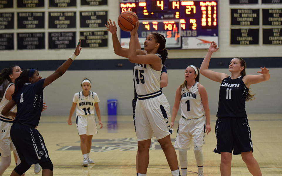 Junior forward Nadine Ewald goes up for a lay-up versus Drew University.