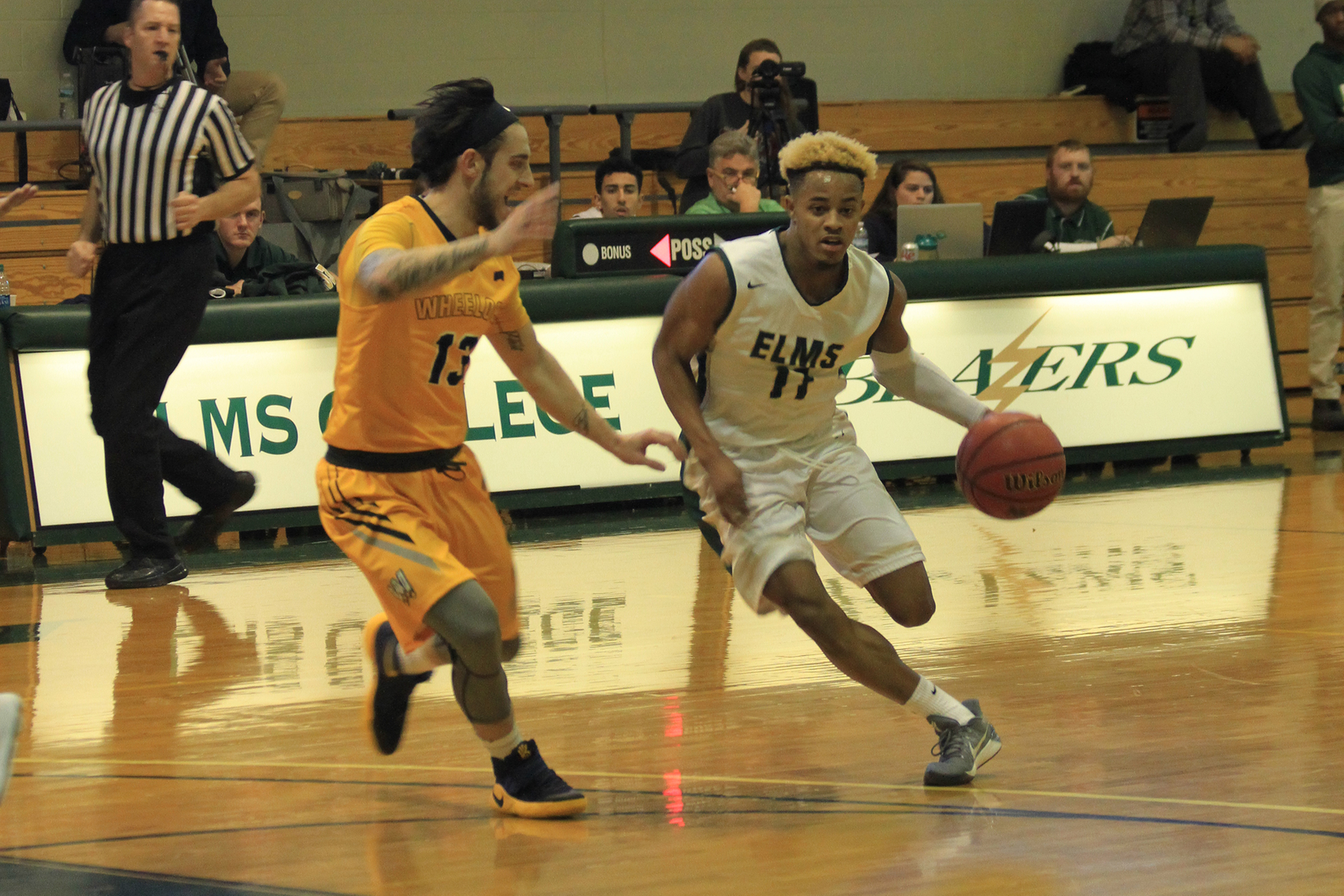 Wheelock Outlasts Men's Basketball