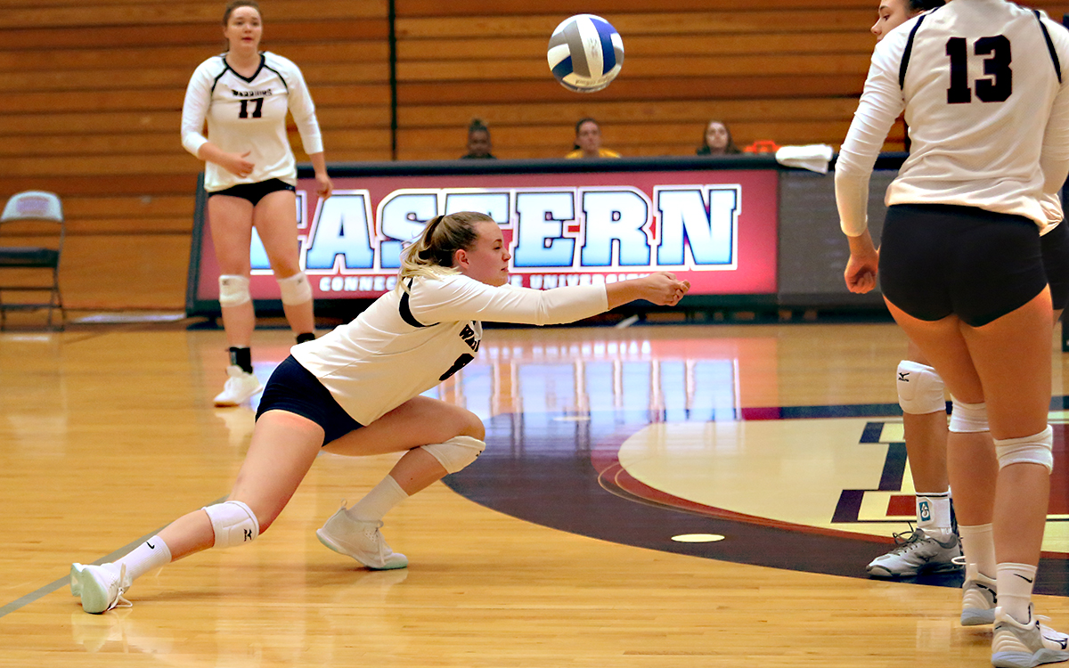 Senior Sierra Orr records one of her eight digs when the Warriors opened their home season Saturday at Francis E. Geissler Gymnasium. (Photo by Sara Pisanelli)