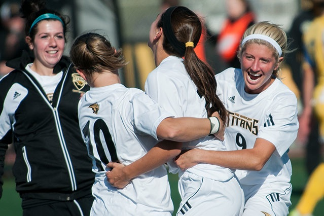 Members of the Titans celebrate after Amanda Baalke's match-winning goal