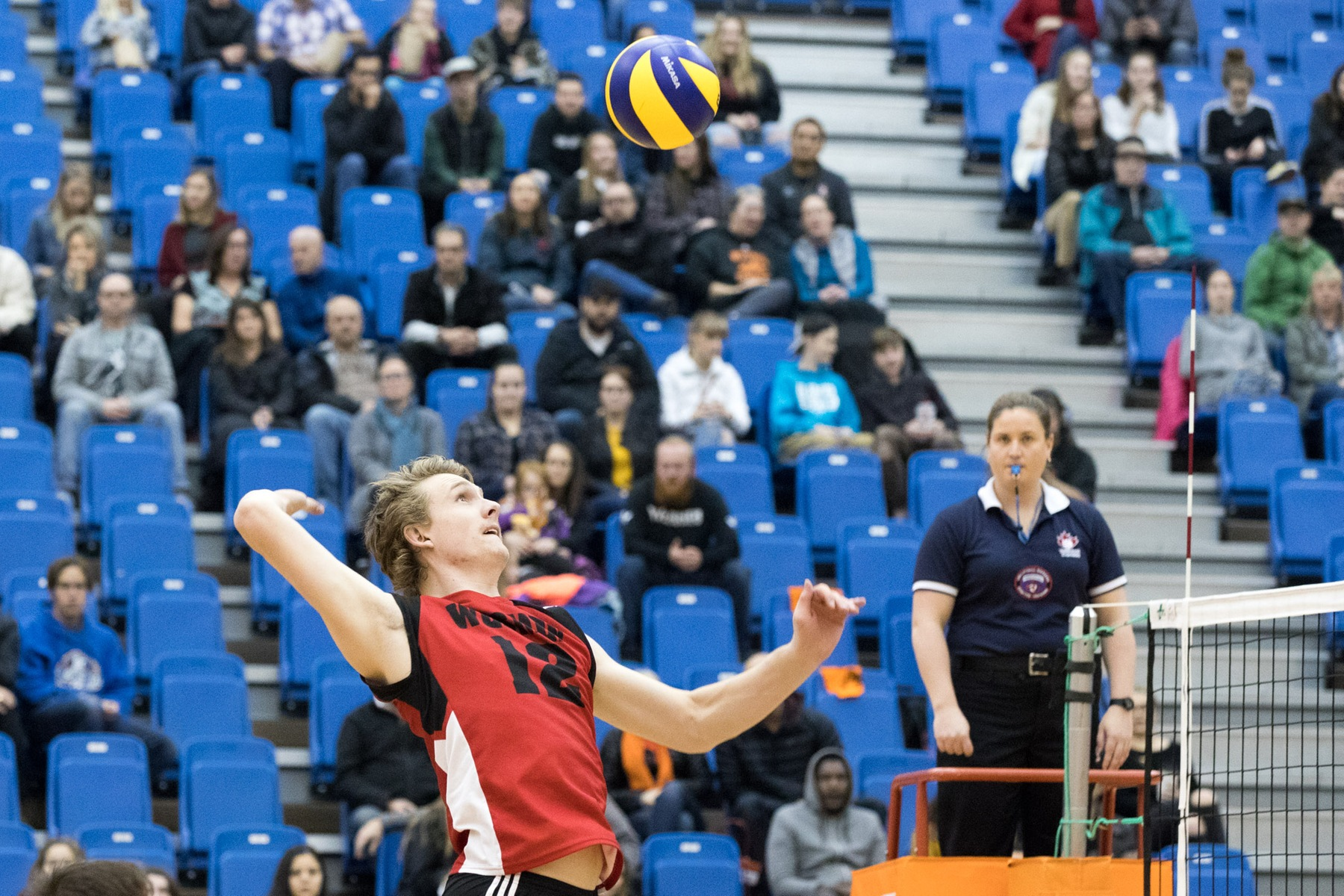 Middle blocker Garrett Jones takes a swing during the Wesmen's match with the Thompson Rivers Wolfpack, Saturday, Nov. 17, 2018 in Kamloops, B.C. (Andrew Snucins/TRU Athletics)