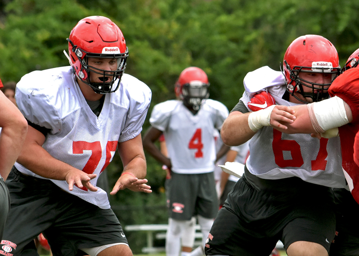 Preseason All-American guard Chris Hering (left) and All-Conference center Adam Mann (right) anchor the Hawks' offensive line. The two seniors lead a unit that returns five players who earned starts last season.