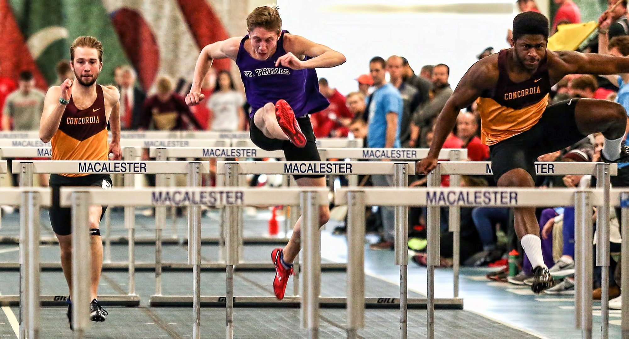 Willie Julkes (R) races through the 60-meter hurdles on his way to finishing in fifth place in the event. (Photo courtesy of Nathan Lodermeier)