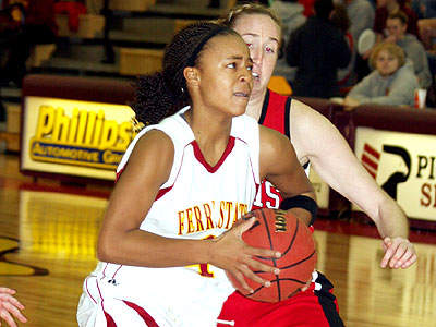 FSU's Tiara Adams drives to the basket in Tuesday's game against Lewis (Photo Courtesy Big Rapids Pioneer)