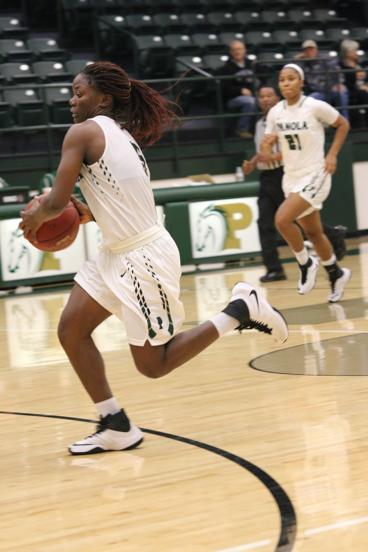 Freshman Patience Okpe goes for 16 and Sophomore Genesis Rivera (21) goes for 16 as well. Photo courtesy of Theresa Beasley.