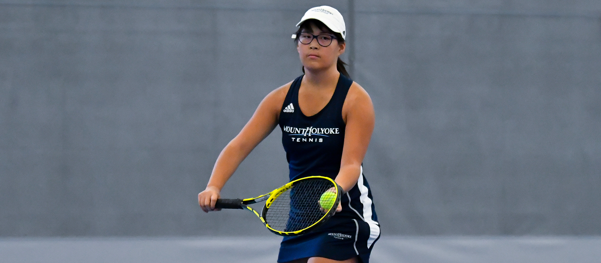 Action photo of Lyons tennis player, Hannah Middleton.