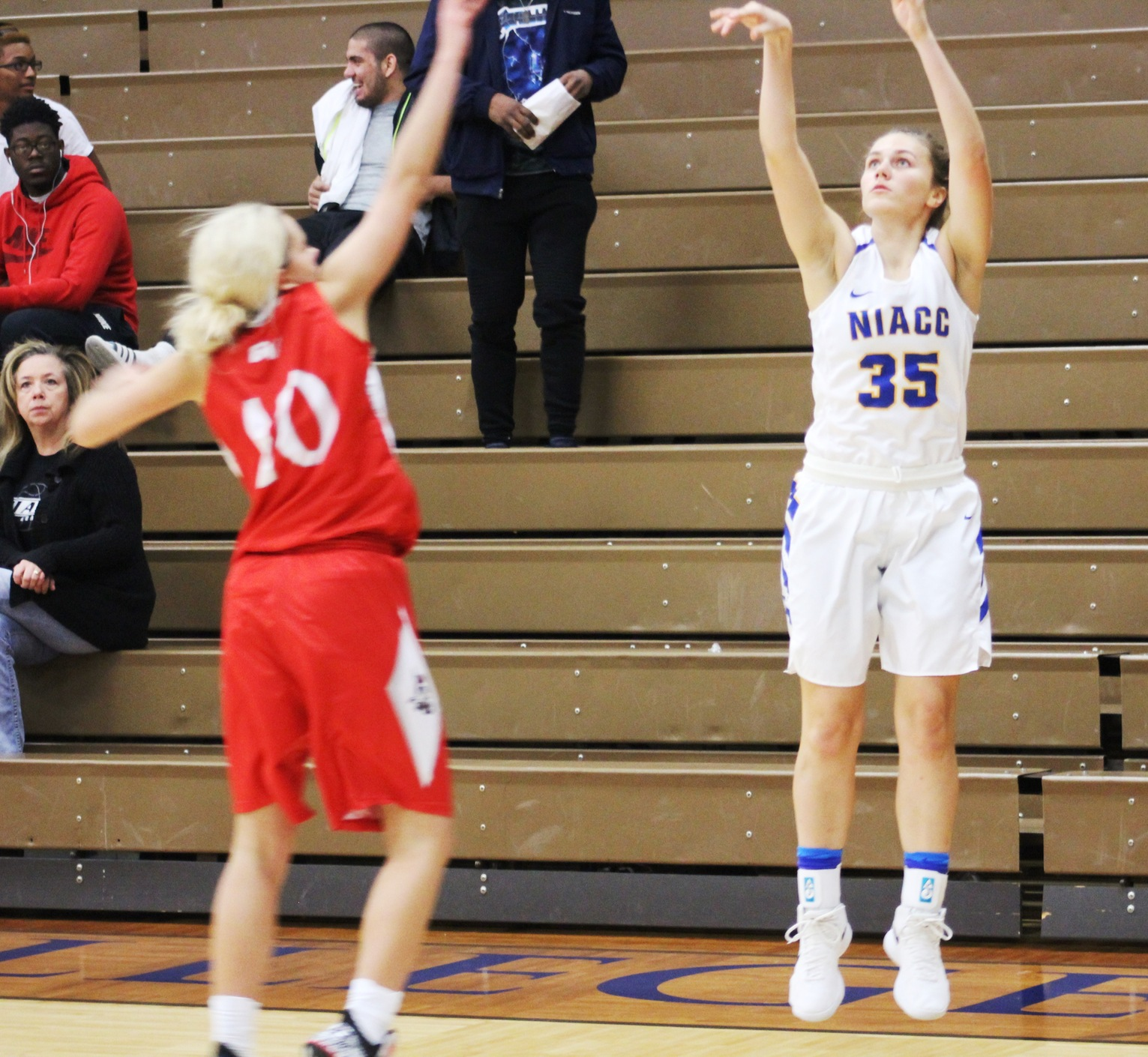 Kelsie Willert connects on a 3-point goal in the second half of Sunday's game against the Grand View Junior Varsity.