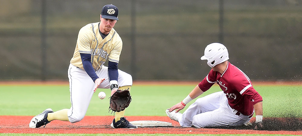 Gallaudet's Cameron Upton makes a catch at second base while a runner slides into the base at the same time.
