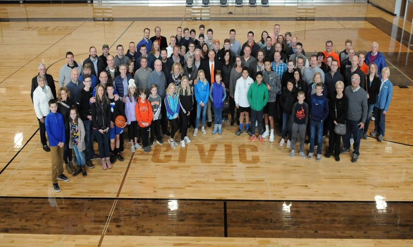 Hope men's basketball players from the 1990s and their families for a picture at the Holland Civic Center