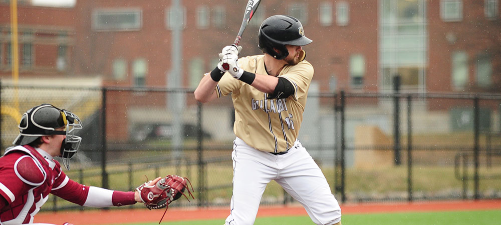 Gallaudet baseball player Ryan Gilbert stands at the plate ready to hit.