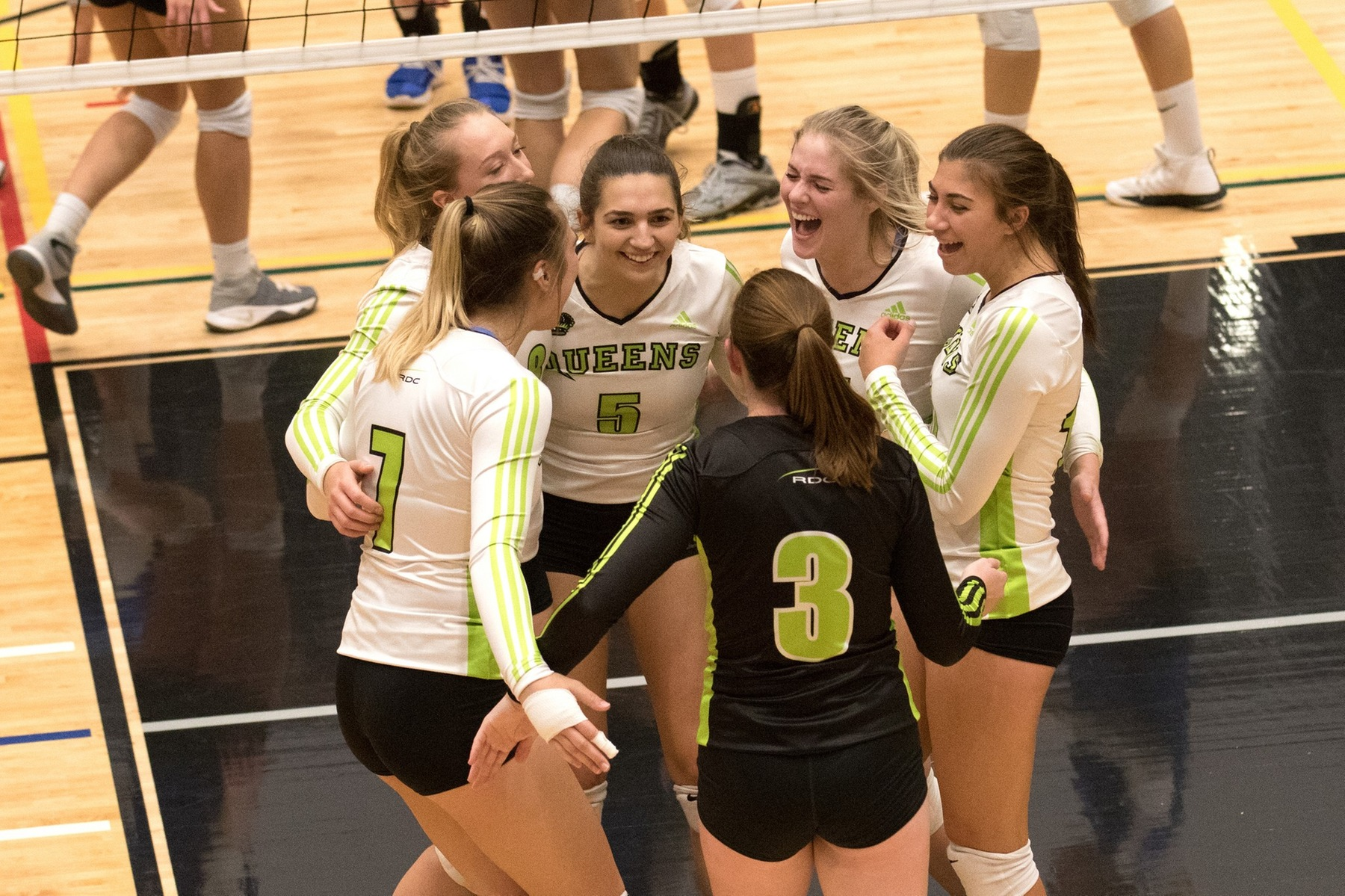 Trojans down Queens in five sets