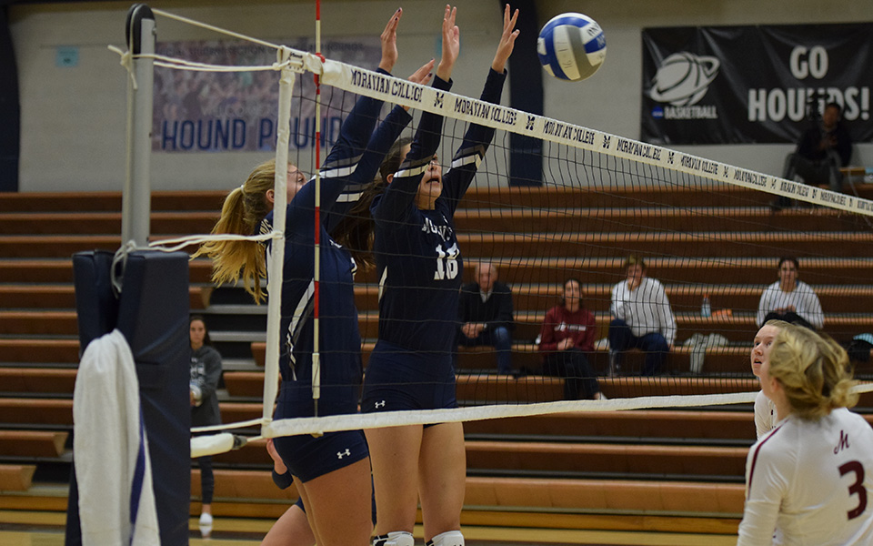 Freshman Sela Herber and Renee Mapa block a ball back versus Muhlenberg College in Johnston Hall.