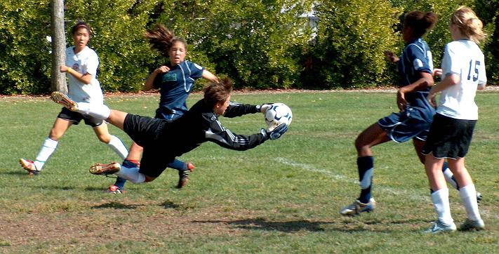 Santa Clara's Bianca Henninger saves a shot from Stanford's Lindsay Taylor in a U15 league.