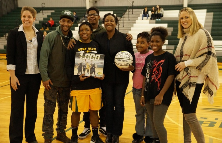 Samiaya Salley, joined by her family, previous SUNY Delhi leading scorer Jennifer LePinnet-Clark and Coach Vicki Andruszkiewicz.