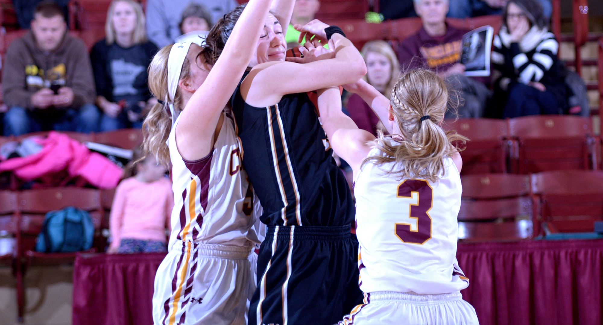 Concordia guards Lexi Nelson (L) and Greta Walsh pressure an Ole player with the ball during the Cobbers' gamer with St. Olaf.
