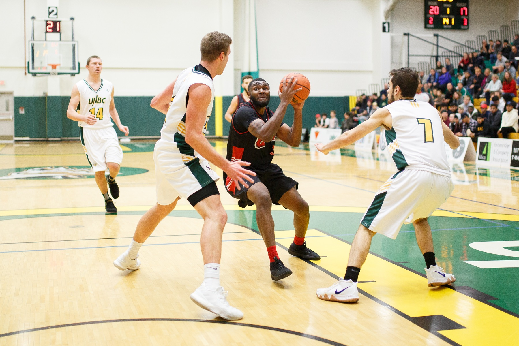 Narcisse Ambanza drives to the hoop during the Winnipeg Wesmen's loss to the UNBC Timberwolves on Friday, Nov. 2, 2018. (UNBC Athletics photo)