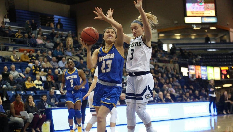 Coco Miller (23) puts up a shot against Karley Eaton (3) in the Gauchos' 80-44 loss to UC Davis at The Pavilion in Davis, Calif. (Photo courtesy of Owen Yancher)
