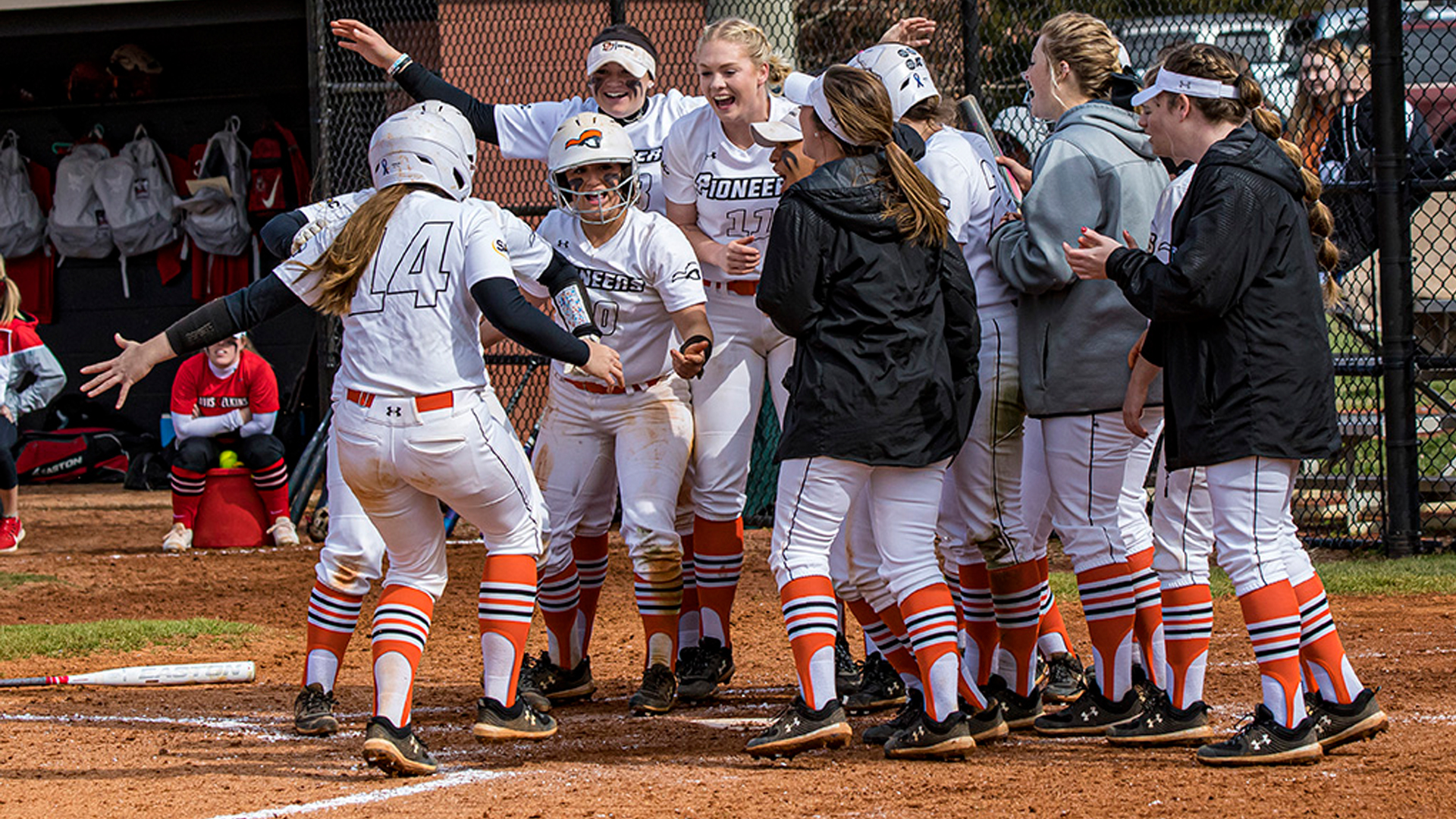 Choloe Freischmidt hits a grand slam in game one to spark a Sunday DH sweep over Davis & Elkins (photo by Chuck Williams)