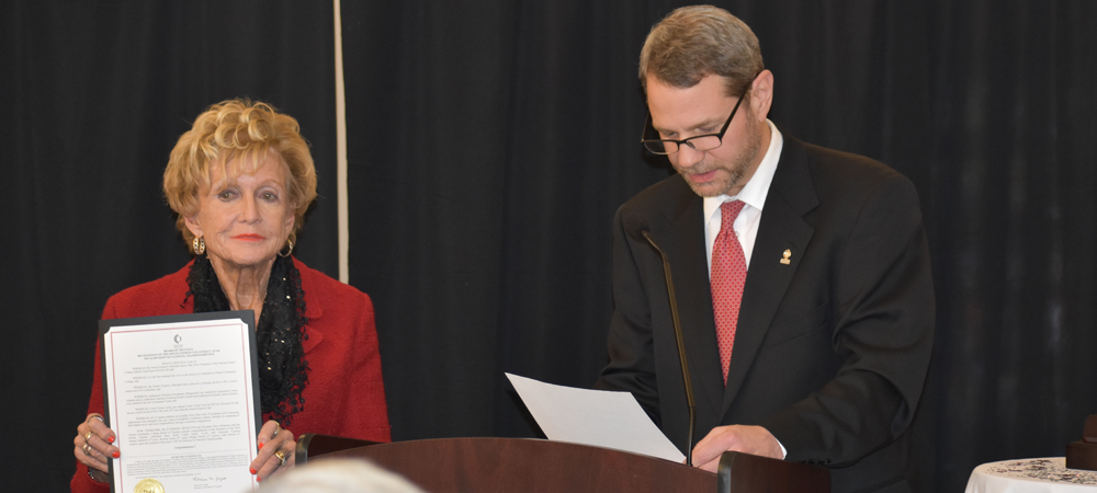 Owens President, Dr. Steve Robinson, reads a proclamation from the Owens Board of Trustee, while Board Chairman, Diana Talmage, looks on.