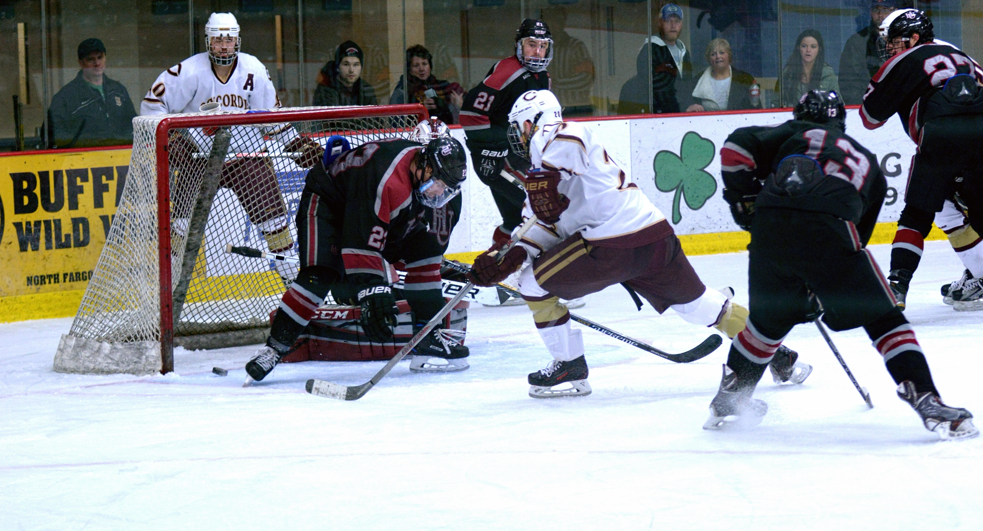 Garrett Hendrickson (behind net) has his centering pass trickle off a skate and hit the post in the final minute of the Cobbers' series finale with Hamline.
