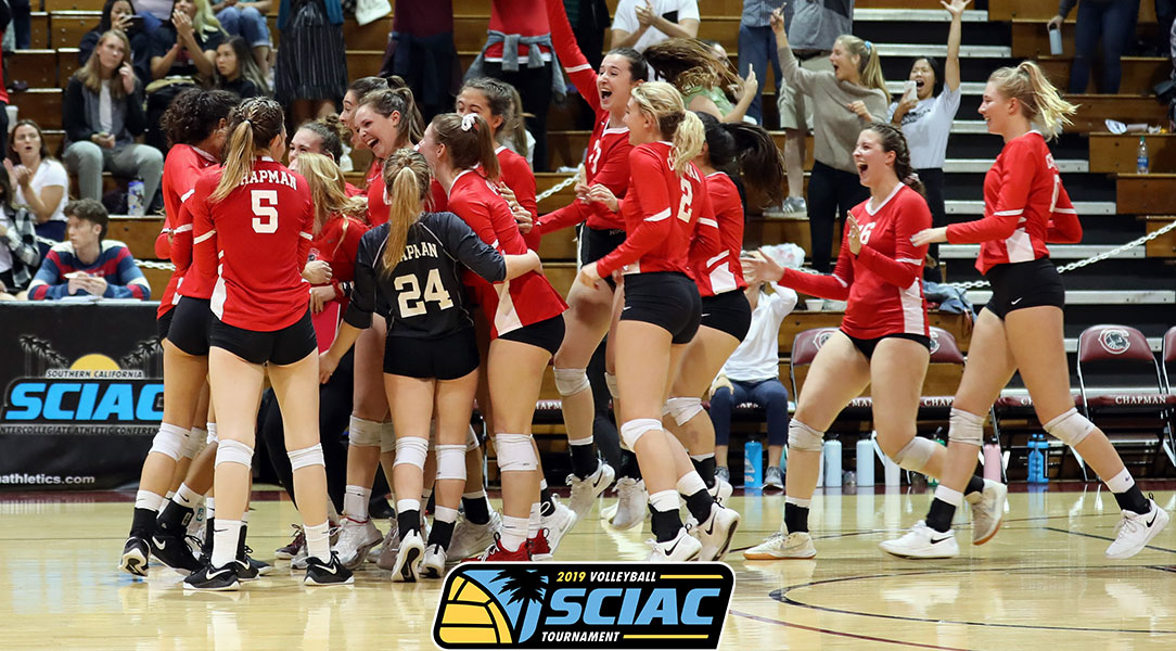 The women's volleyball team celebrates winning the SCIAC Semifinal match.
