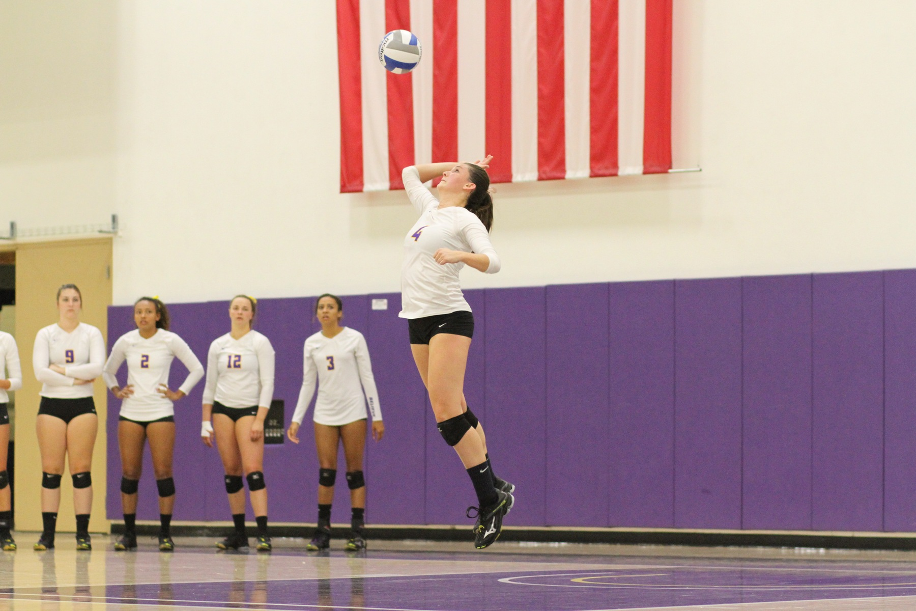 Regals Fend Off Bulldogs in Four Sets