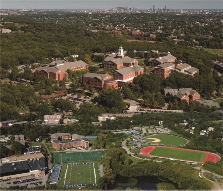 Bentley University from the air, with Boston in the background