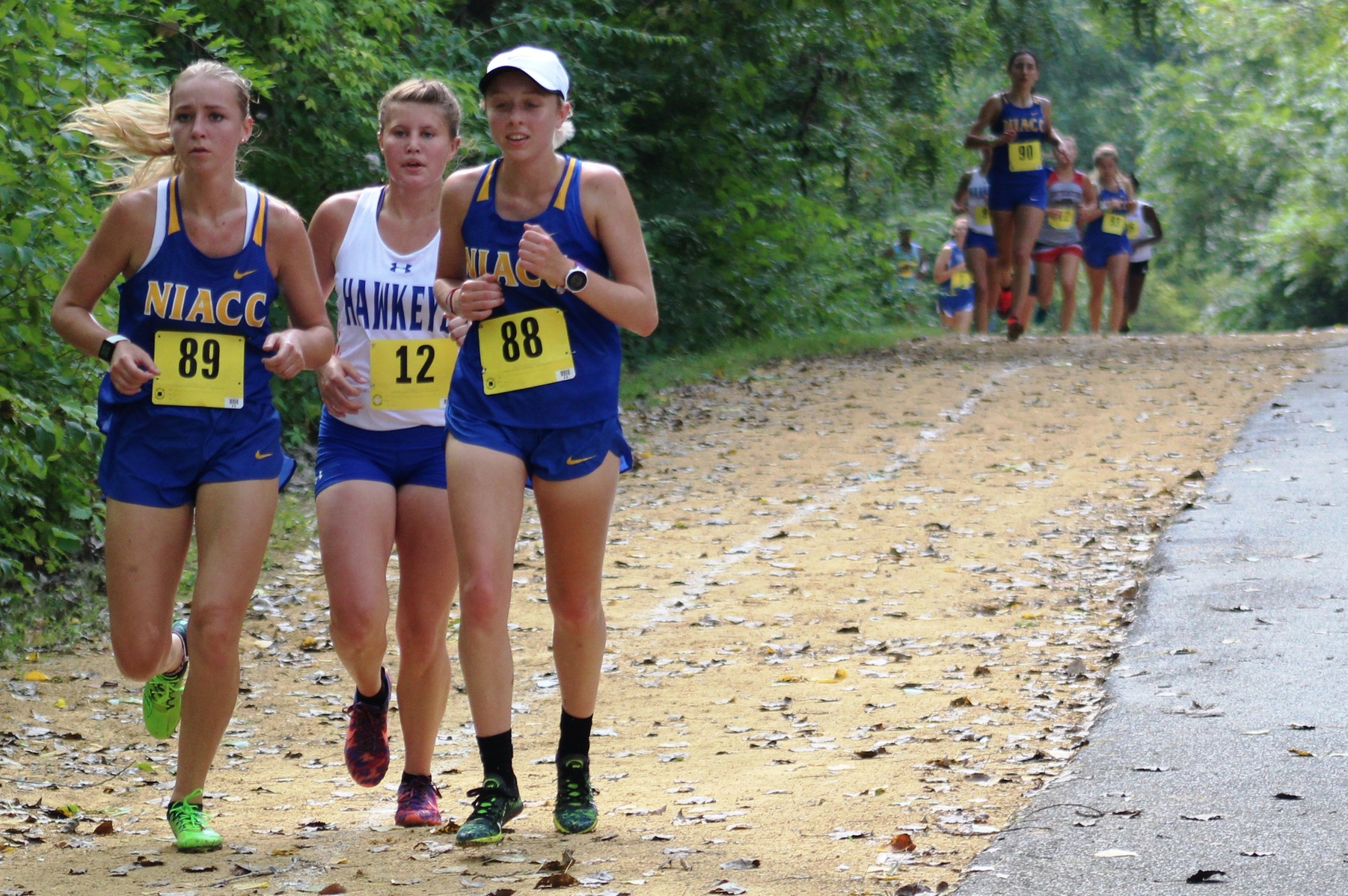 NIACC's Cecelia Hemsworth and Julia Dunlavey run at the regiona time trial in Davenport in August.