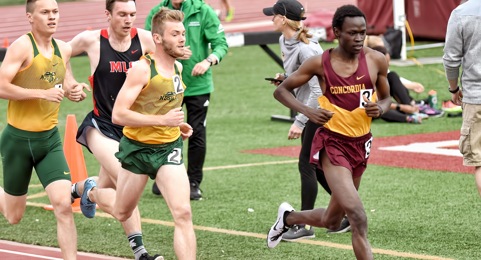Sophomore Munir Isahak breaks away from a pack during fourth-place finish in the 1500 meters at the Cobber Twilight.