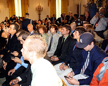 Gallaudet players sitting in the East Room of the White House