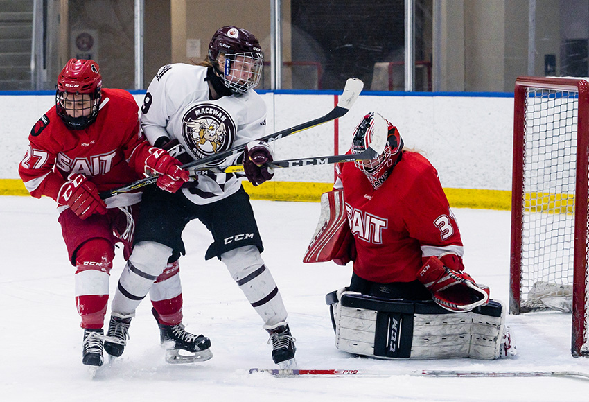 Jordyn Reimer gets a chance on SAIT goalie Elisha Oswald in a game earlier this season. The fourth-year forward is getting rewarded offensively for her hard work (Matthew Jacula photo).
