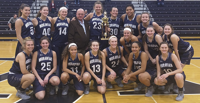 Moravian posing with the team championship trophy after winning the 2017 Rinso Marquette Tournament at Lebanon Valley College.