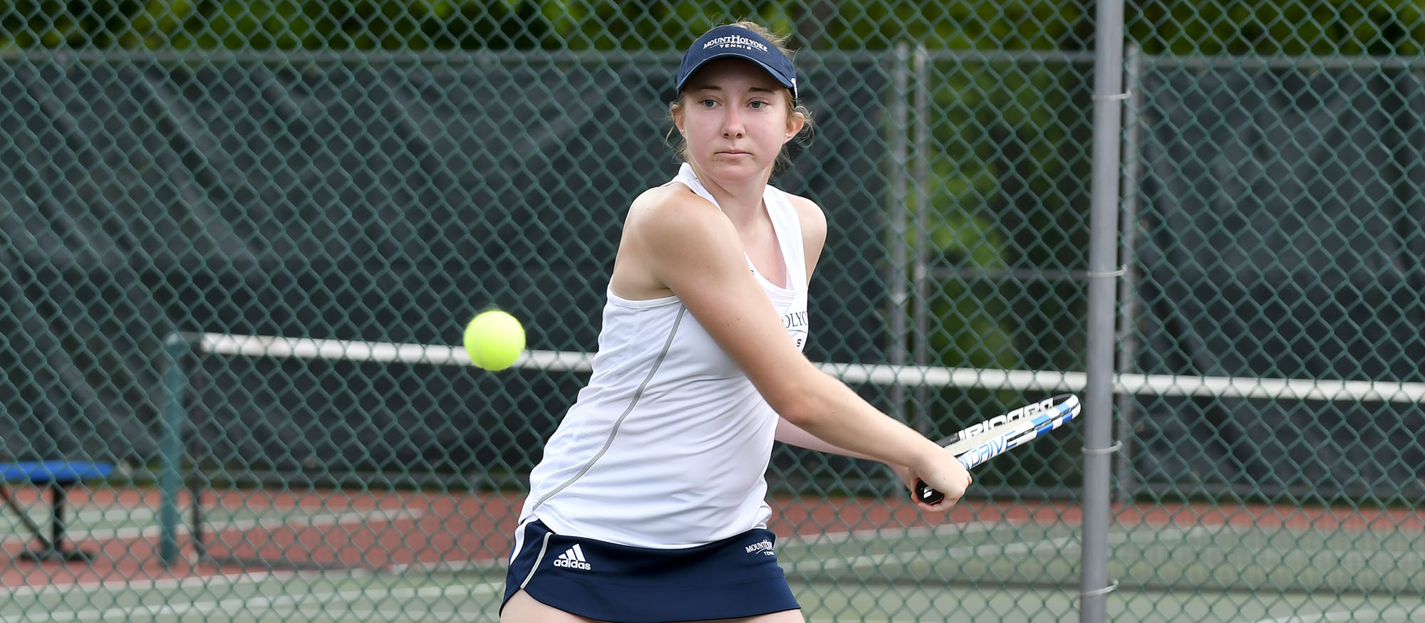 Action photo of Lyons tennis player Katherine Schumacher
