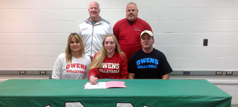 Michaela Eisenhauer is accompanied by her parents, Heather and Scott, along with Owens volleyball assistant coaches Denny Caldwell and Bill Bonham on signing day. Photo provided to Owens Sports Information