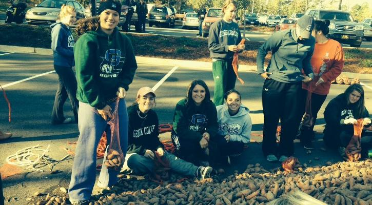 Bobcat Softball Helps at Potato Drop