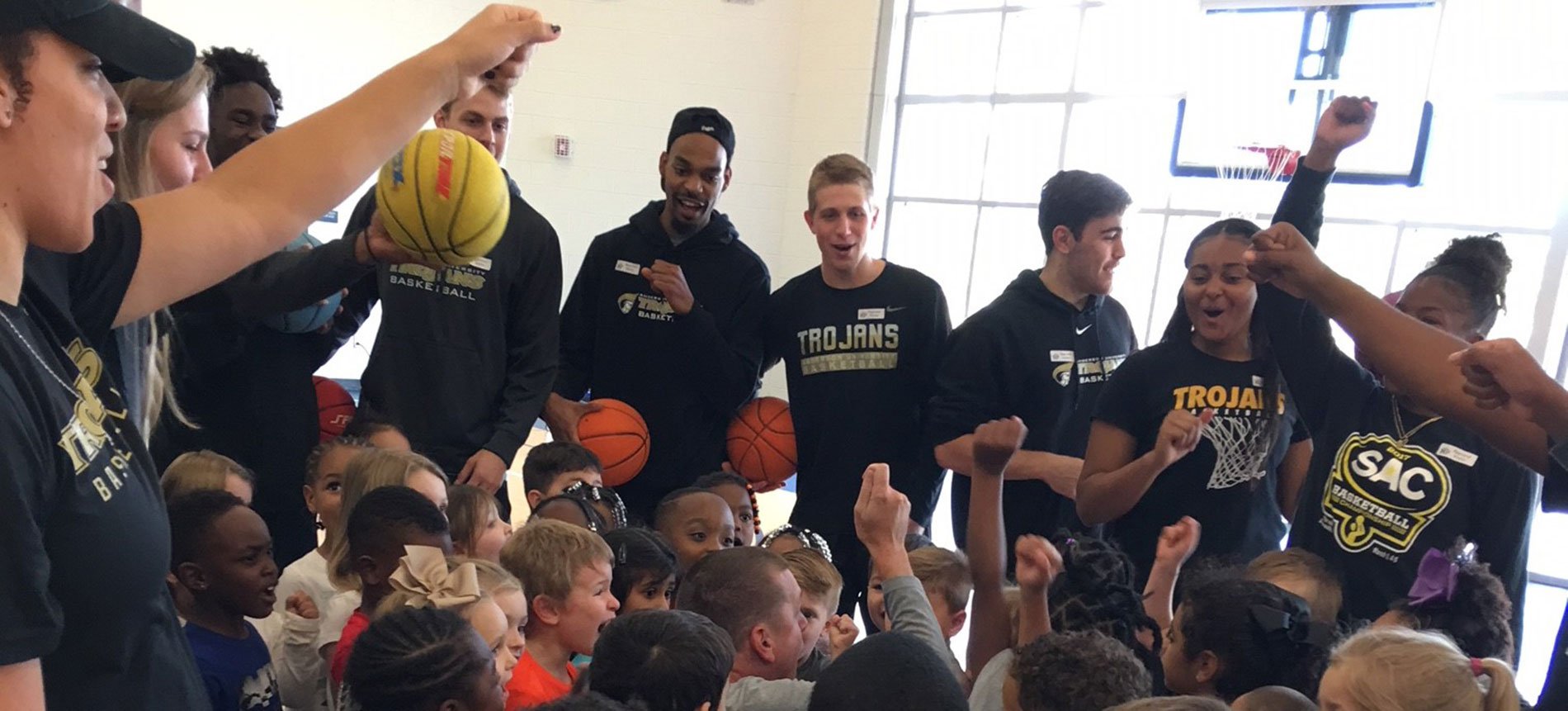 Men's and Women's Basketball Spend Morning at North Pointe Elementary