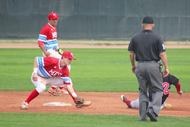 Mesa's Garrett Smith tags out a would be base stealer. (photo by Aaron Webster)