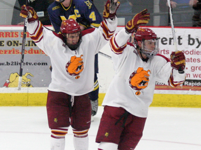 Casey Haines (left) and Blair Riley (right) celebrate the Bulldogs' dramatic 3-2 victory over Michigan.  (Photo courtesy of The Pioneer)