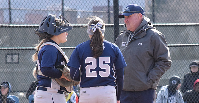 Head Coach John Byrne '82 talks with Janae Matos '18 and Josie Novak '18 during his 800th career victory versus DeSales University at Blue & Grey Field.