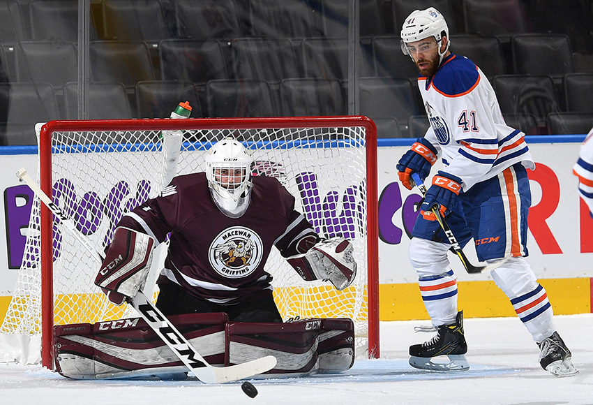 MacEwan goalie Marc-Olivier Daigle makes a save in front of Oilers' rookie Evan Polei on Wednesday night. Daigle and NAIT's Nathan Park combined for a 49-save shutout (Photo courtesy Edmonton Oilers).