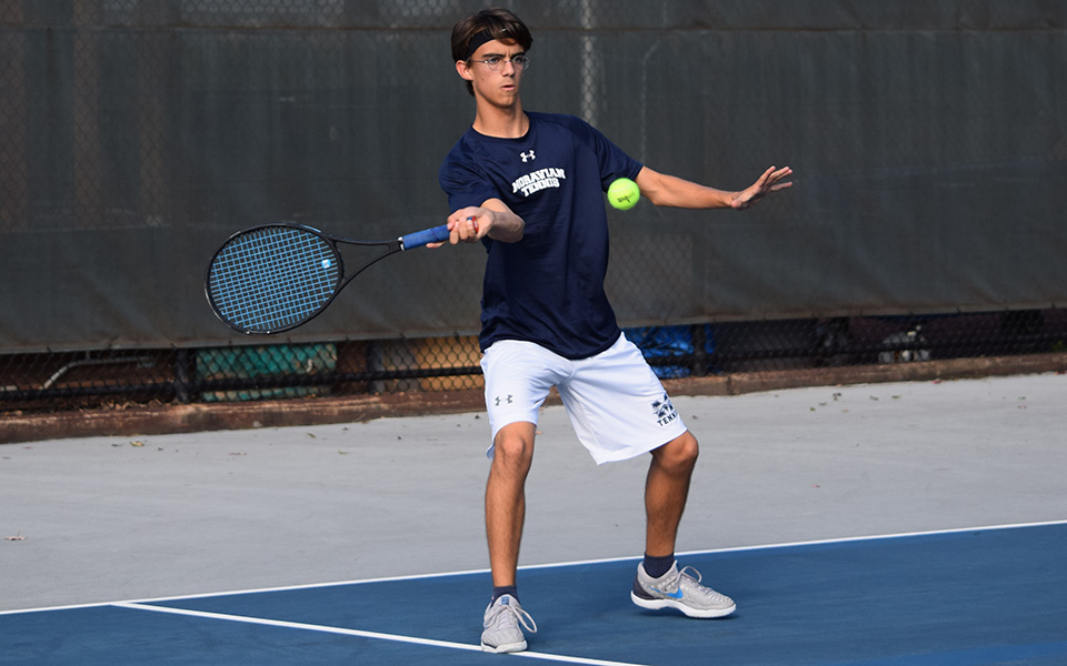 Neil Guarino returns a shot in doubles action versus FDU-Florham at Hoffman Courts.
