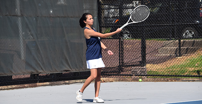 Grace Bailly '18 warms up for a Landmark Conference Semifinal match versus The Catholic University of America on Hoffman Courts in May 2018.