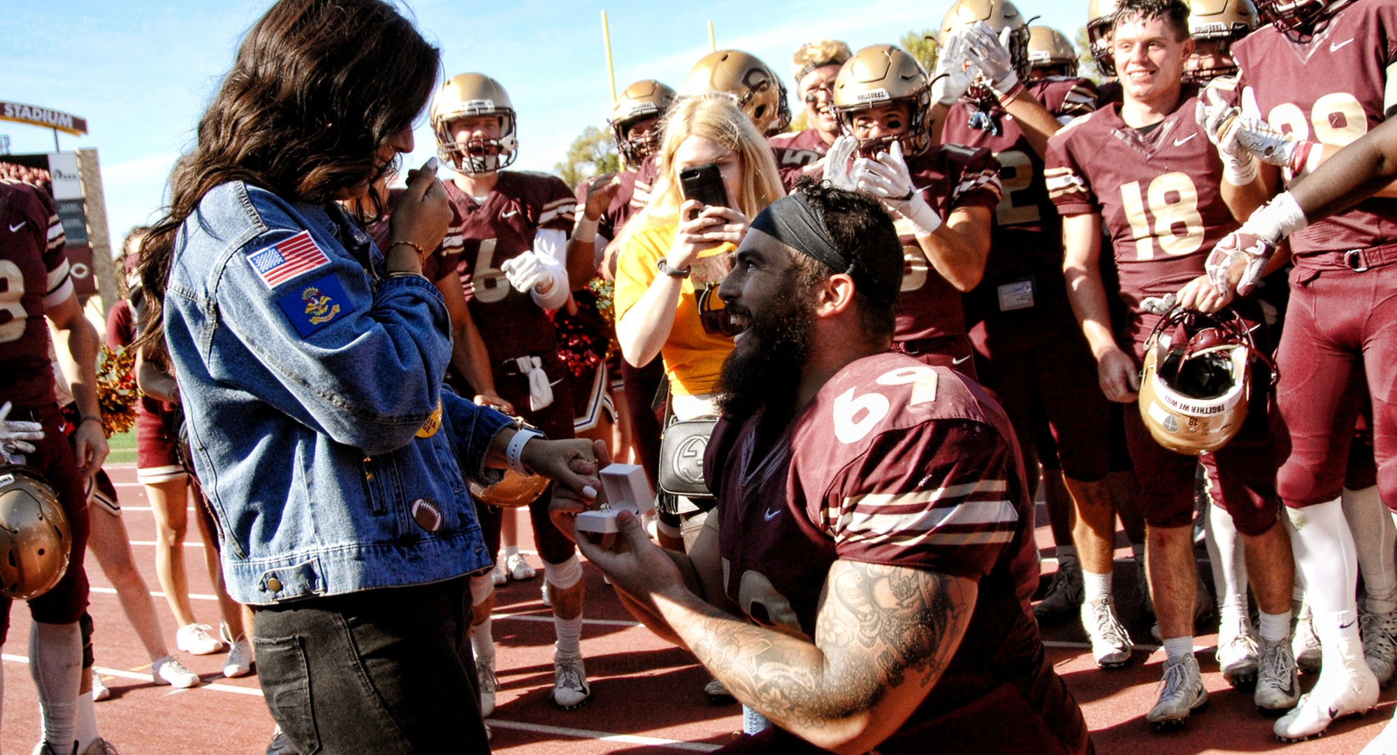 Senior Gunnar Kollman proposes to his girlfriend after the Cobbers' 55-0 win over Hamline.