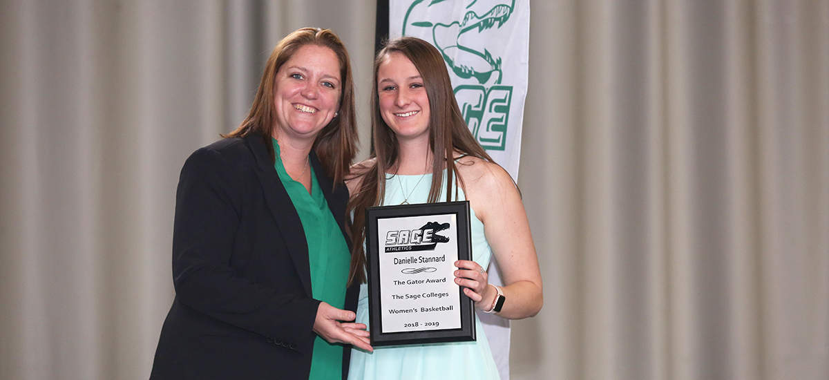 Head Women's Basketball Coach Allison Coleman awards Gator of the Year honors to Danielle Stannard