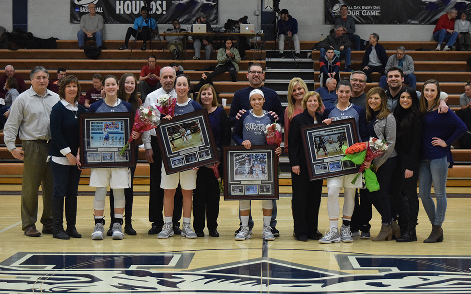Moravian College honored women's basketball seniors Ariana Caiati, Caitlin Flanagan, Tyis Mullen and Emily Walls before the Greyhounds' game versus Susquehanna University in Johnston Hall.